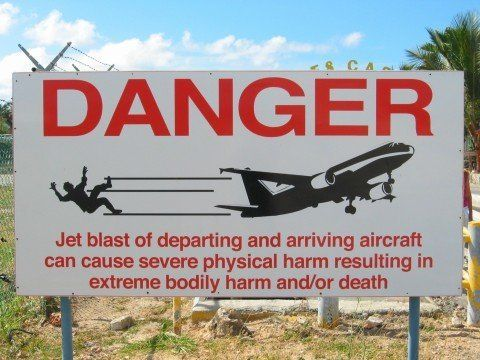 A warning sign is seen outside of Princess Juliana International Airport in St. Martin.