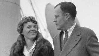 The American Aviatrix, Amelia Earhart is shown with her husband George Palmer Putnam on the deck of a ship.