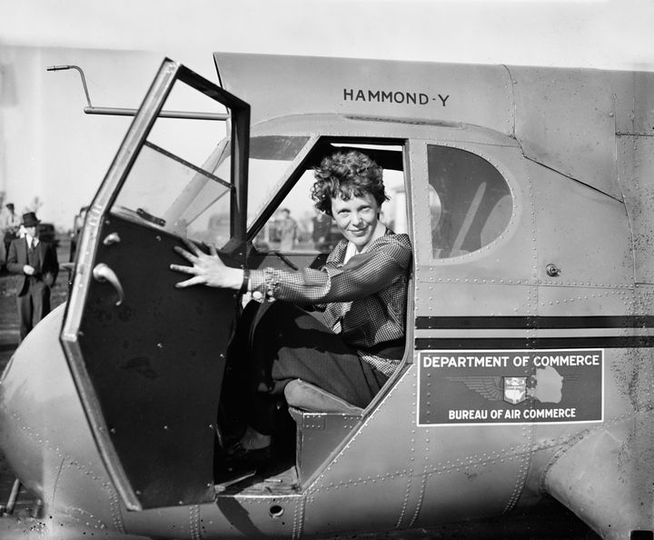 Earhart sitting in an airplane, 1936.