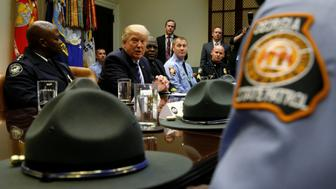 U.S. President Donald Trump welcomes police and firefighters who responded to the recent Interstate 85 fire and roadway collapse in Atlanta at the White House, in Washington, D.C., U.S., April 13, 2017. REUTERS/Jonathan Ernst