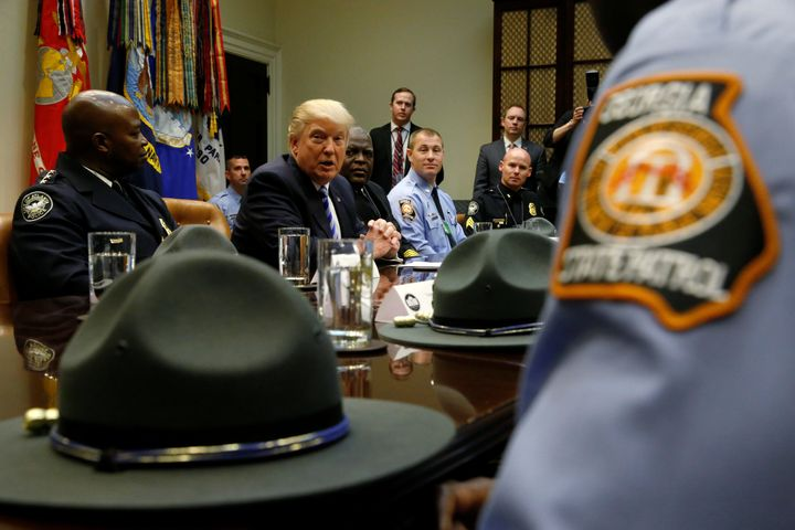 President Donald Trump welcomes Georgia police officers and firefighters at the White House on April 13. The National Fratern