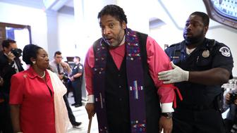 WASHINGTON, DC - JULY 13:  NAACP North Carolina President Rev. Dr. William Barber (C) is arrested for protesting against new GOP health care legislation in Senate Majority Leader Mitch McConnell's offices on Capitol Hill July 13, 2017 in Washington, DC. The latest version of the proposed bill aims to repeal and replace the Affordable Care Act, also knows as Obamacare.  (Photo by Chip Somodevilla/Getty Images)