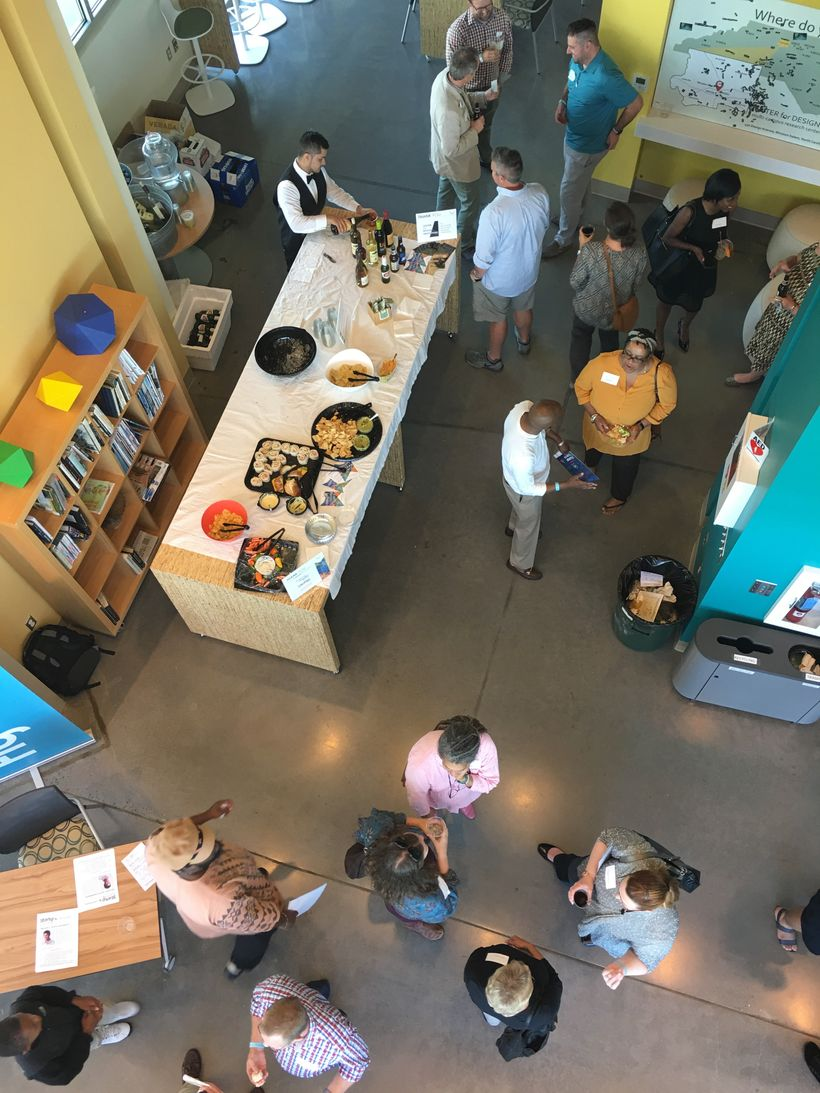 An aerial view of tasty treats, wine, and conversation at a Thursday Gathering in the Atrium of BioTech Place at Wake Forest.