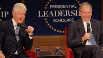 Former U.S. Presidents Bill Clinton (L) and George W. Bush participate in a moderated conversation at the graduation class of the Presidential Leadership Scholars program at the George W. Bush Presidential Library in Dallas, Texas, U.S., July 13, 2017. REUTERS/Brandon Wade
