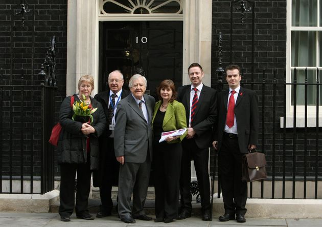 Haemophilia Society members deliver a copy of the Archer reportto Downing