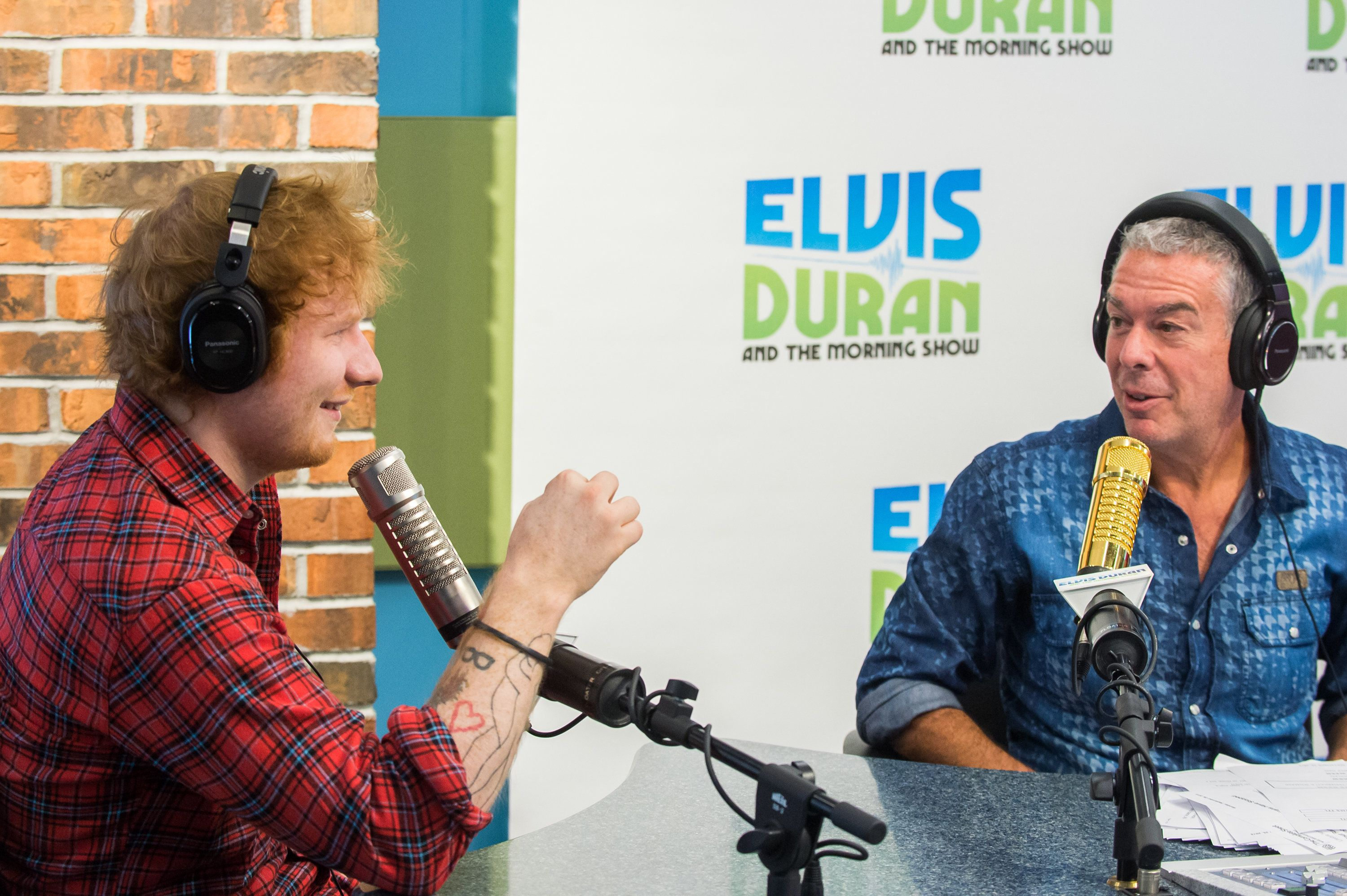 NEW YORK, NY - SEPTEMBER 28:  Singer Ed Sheeran (L) and Radio Host Elvis Duran attend 'The Elvis Duran Z100 Morning Show' at Z100 Studio on September 28, 2015 in New York City.  (Photo by Mark Sagliocco/Getty Images)