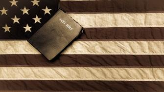 King James Bible with a vintage American flag in the background.