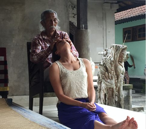 Cokorda Rai doing his check up on me.