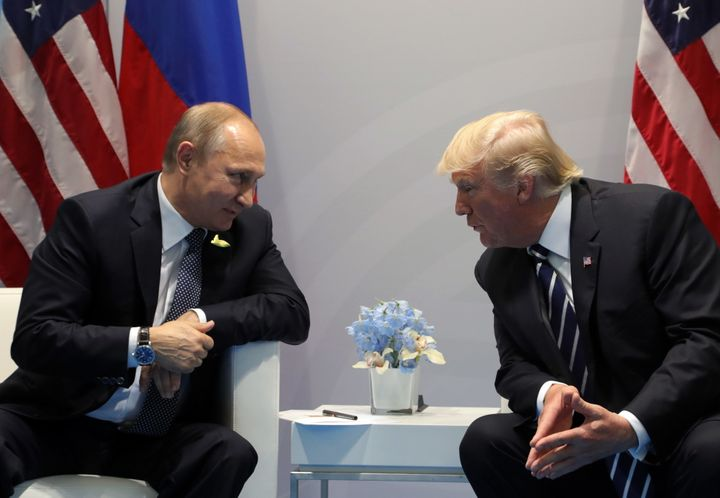 Russian President Vladimir Putin and President Donald Trump talk during a meeting on the sidelines of the G20 summit in Hambu