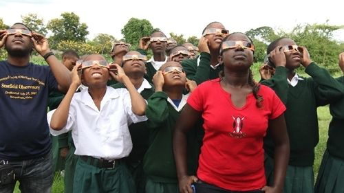 Students wearing eclipse glasses. You <em>must</em> wear these special glasses to look at the Sun during a solar eclipse safe