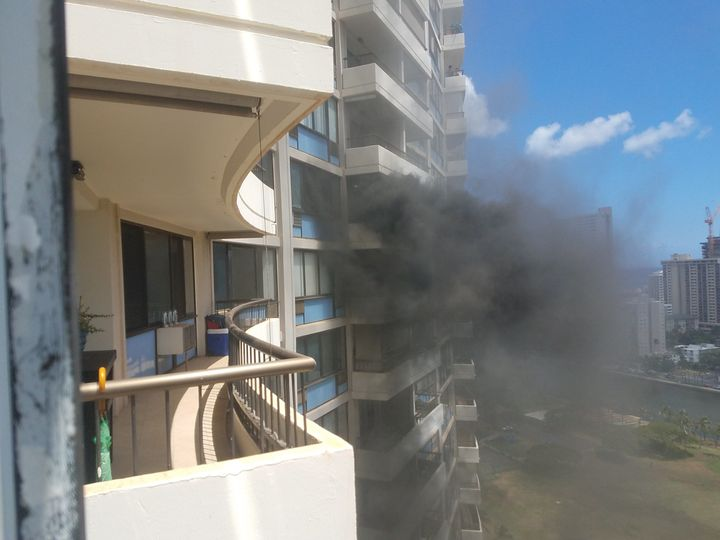 After hearing a fire alarm, Joel Horiguchi looked out from the balcony of his Marco Polo residence and saw thick sm