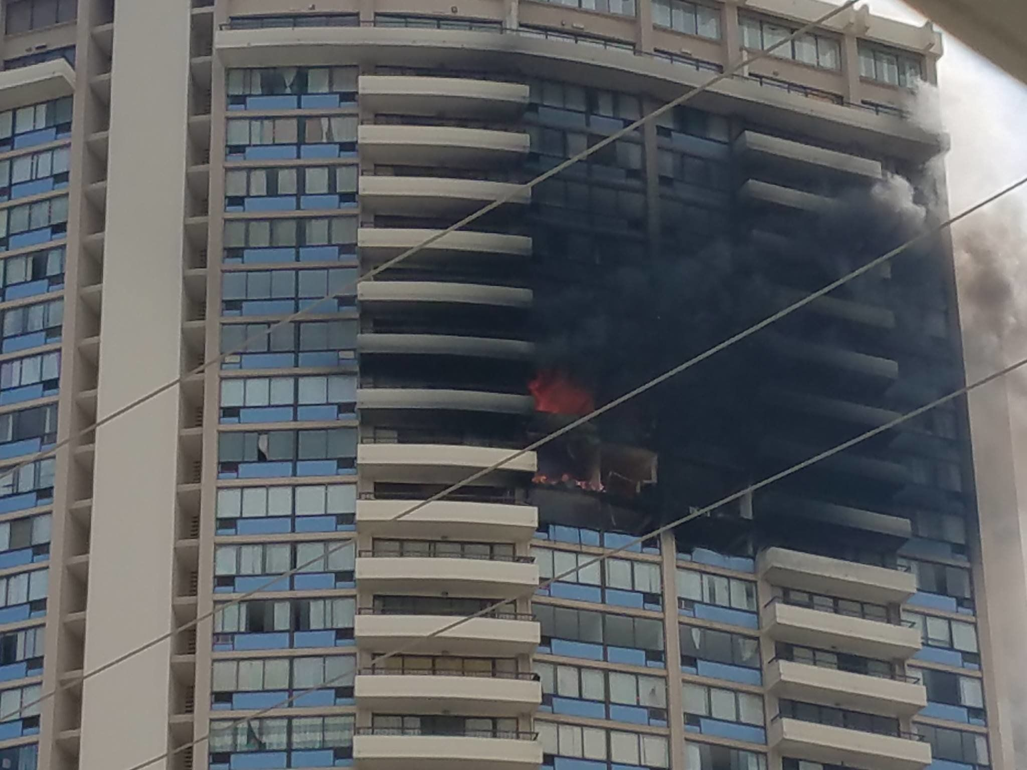 Joel Horiguchi, a resident of Marco Polo, took this photo of the building on fire about 4:50 p.m. local