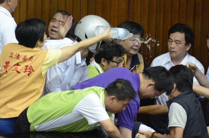 Taiwanese legislators fight in parliament onAug. 2, 2013.