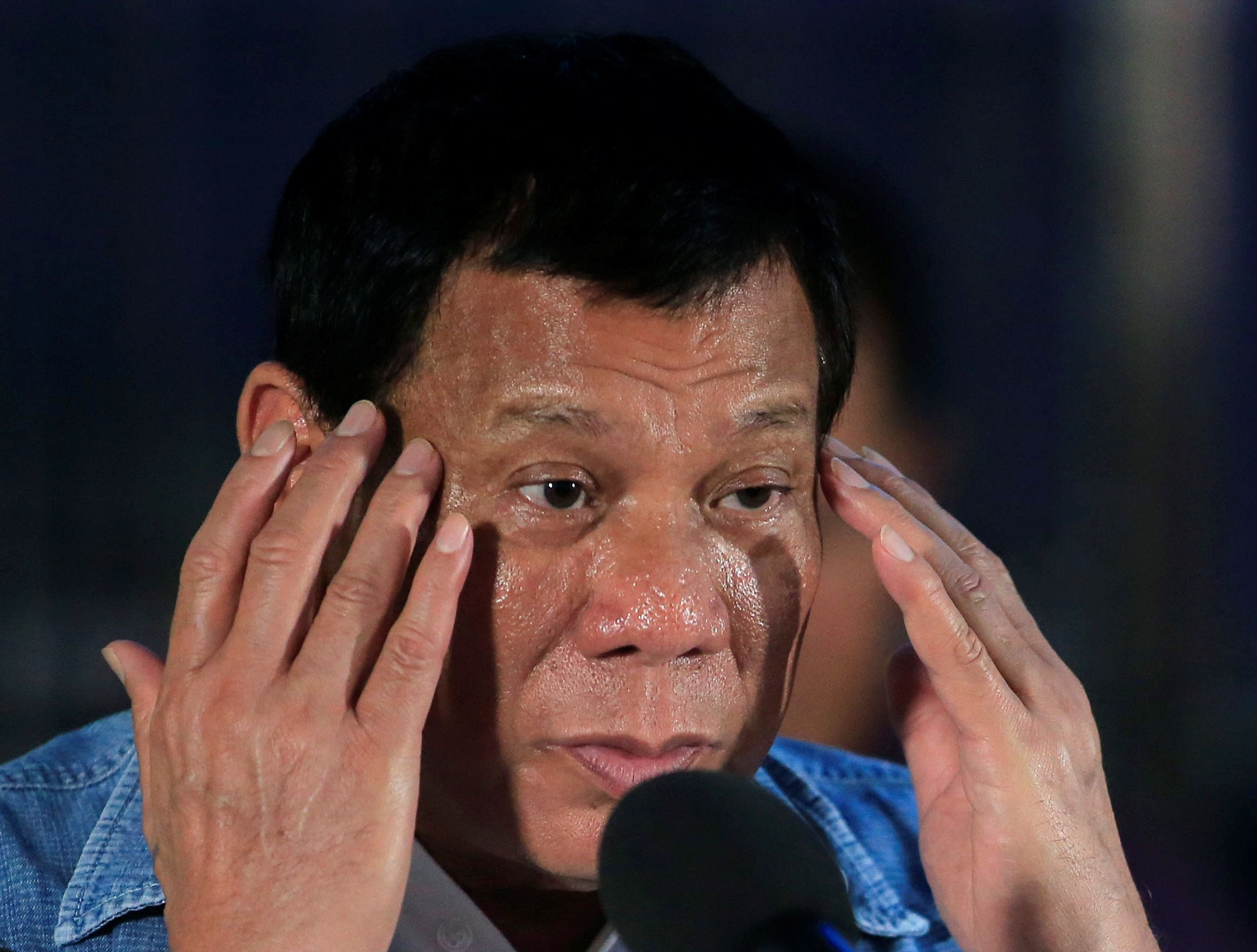 Philippines' President Rodrigo Duterte gestures while delivering a speech during his visit at the Iligan City National School of Fisheries evacuation center in Iligan City, Philippines June 20, 2017. REUTERS/Romeo Ranoco