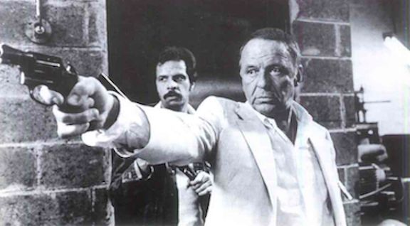 <strong><em>Sinatra taking charge on the set of Contract on Cherry Street</em></strong>