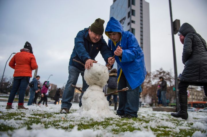 Snowman-building in Santiago on Saturday.
