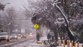 View of a street covered with snow in Santiago on July 15, 2017.  An unusual snowfall --the first of such intensity since 2007-- surprised the inhabitants of the Chilean capital, causing a few power cuts and minor traffic jams, in particular in the eastern areas of the capital, the closest to the Andes mountain range. / AFP PHOTO / Martin BERNETTI        (Photo credit should read MARTIN BERNETTI/AFP/Getty Images)