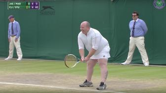 Tennis fan Chris Quinn suited up in a white skirt and top after invited to play at Wimbledon