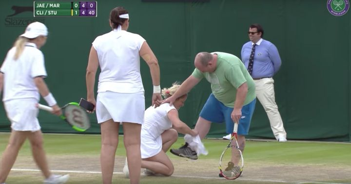 Kim Clijsters helps the man squeeze into a white skirt.