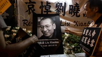 SAI WAN, HONG KONG - 2017/07/14: The death of Chinese Nobel Peace Prize winner Liu Xiaobo outside the Chinese Liaison Office in Sai Wan, Hong Kong. Liu Xiaobo died of cancer in hospital one month after being transferred from prison. (Photo by Chan Long Hei/Pacific Press/LightRocket via Getty Images)
