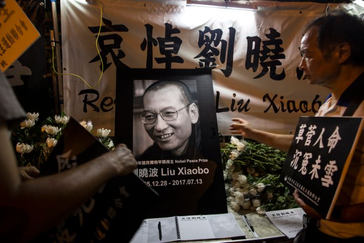 Mourners remember Liu Xiaobo in Hong Kong on Friday. Liu, who was awarded the Nobel Peace Prize in 2010 while impri