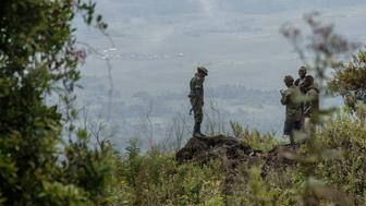 NORTH KIVU, DEMOCRATIC REPUBLIC OF CONGO - 2016/05/20: Rangers stand near a security post on the way to the top of Mount Nyiragongo. The Nyiragongo is an active stratovolcano with an elevation of 3,470 metres in the Virunga National Park, about 20 km north of the town of Goma and Lake Kivu. The Virunga park, created in 1925 under the name of Albert National Park, has a 7,800 km2 superficy and is a UNESCO World Heritage Site. The park employs around 500 rangers who fight against poachers and illegal charcoal producers. (Photo by Thierry Falise/LightRocket via Getty Images)