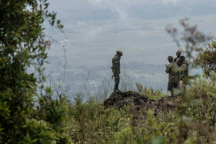 Rangers stand near a security post on the way to the top of Mount Nyiragongo on June 20, 2016.