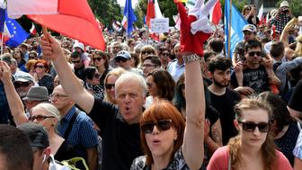 Hundreds of government opponents protest in front of the parliament building in Warsaw, on July 16, 2017 against new legislation that reorganizes Polands judiciary and puts judges under political influence. / AFP PHOTO / JANEK SKARZYNSKI        (Photo credit should read JANEK SKARZYNSKI/AFP/Getty Images)