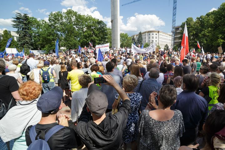 People participate in a protest in front of the Polish Parliament building in Warsaw, Poland on 16 July 2017.
