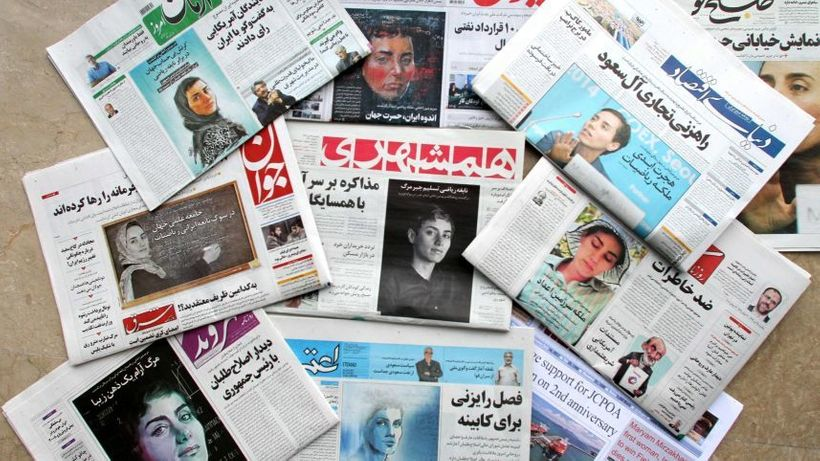 A picture taken in the capital Tehran on July 16 2017, shows some front pages of Iranian newspapers made an unprecedented mov