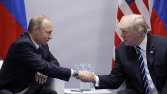 HAMBURG, GERMANY  JULY 7, 2017: Russia's President Vladimir Putin (L) and US President Donald Trump shake hands during a bilateral meeting on the sidelines of the G20 summit in Hamburg. Mikhail Metzel/TASS (Photo by Mikhail Metzel\TASS via Getty Images)