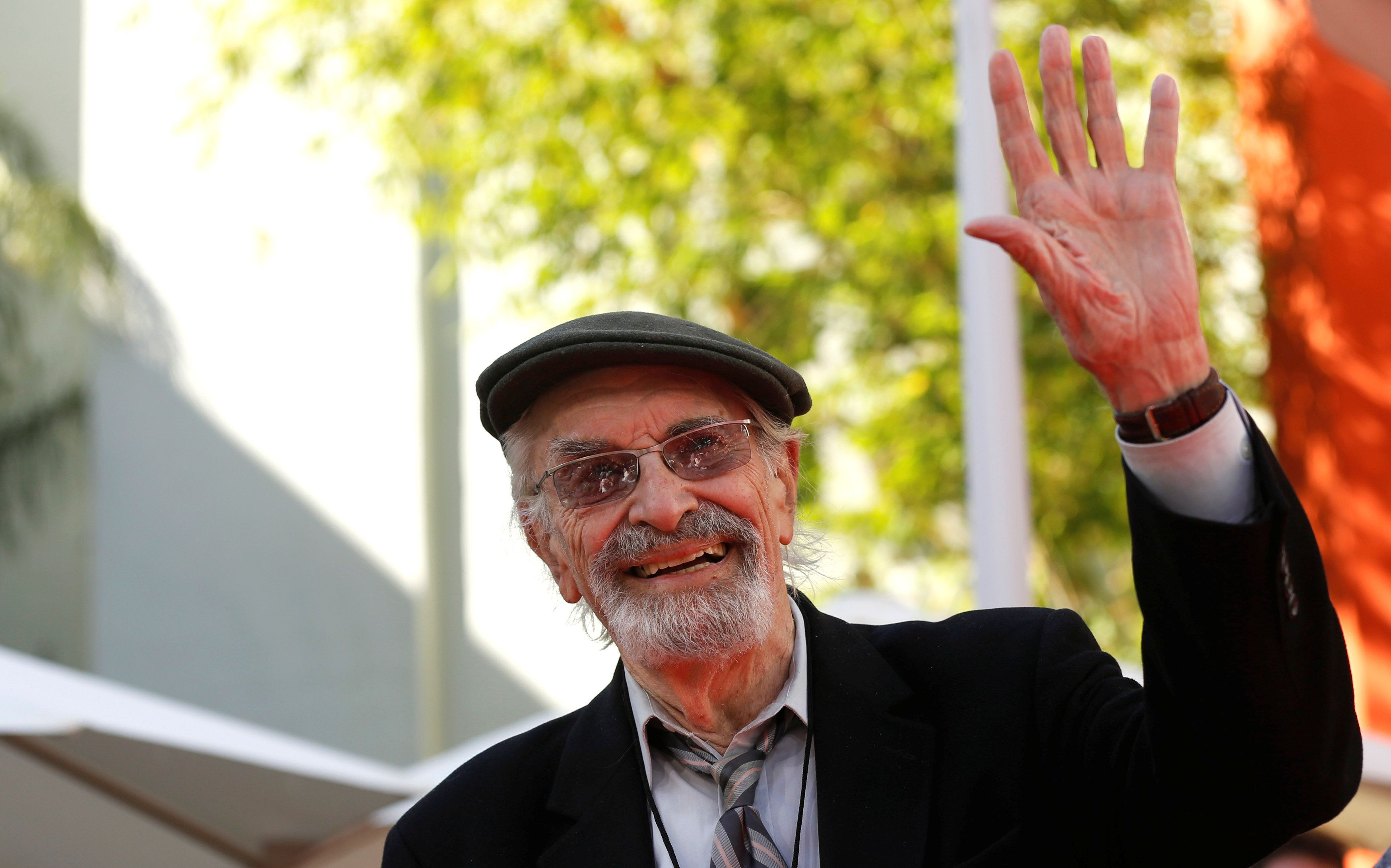 Actor Martin Landau waves at a ceremony for director Tim Burton to place his handprints and footprints in cement in the forecourt of the TCL Chinese theatre in Hollywood, California U.S., September 8, 2016.   REUTERS/Mario Anzuoni