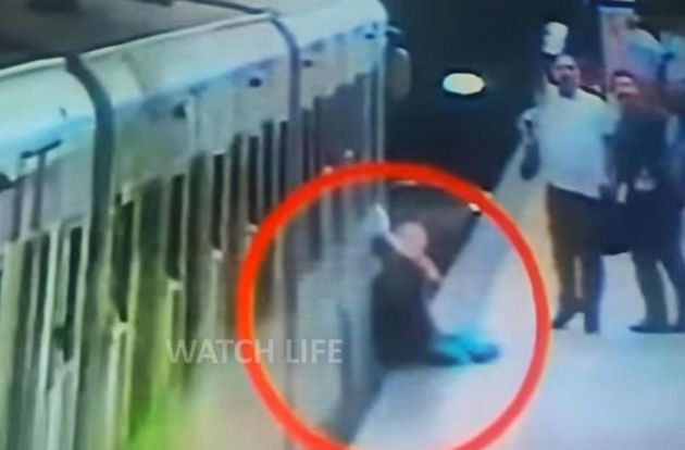 Video showsNatalya Garkovich being dragged along the platform at a Rome Metro station after her...
