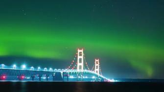 A ribbon of neon green light is seen in the sky over Michigans Mackinac Bridge early Monday