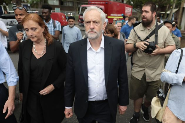 Labour leader Jeremy Corbyn visits the scene of the Grenfell Tower fire with MP for Kensington, Emma...