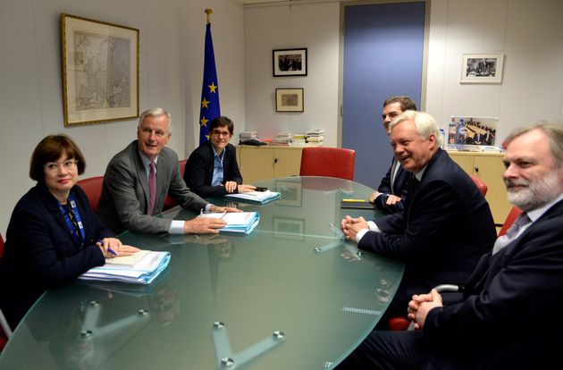 European Union's chief Brexit negotiator Michel Barnier and his delegation and Britain's Secretary of...