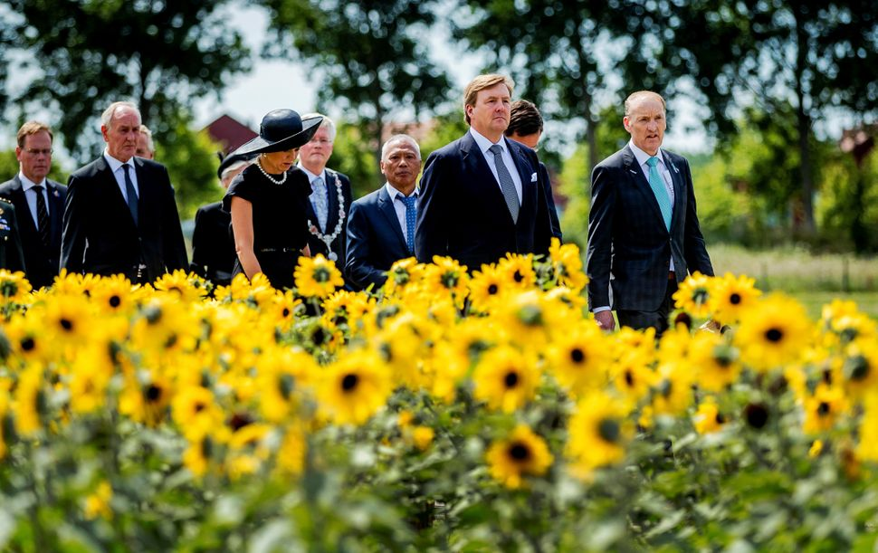 King Willem-Alexander, second from right, and his wife Queen Maxima of the Netherlands arrive to the event.