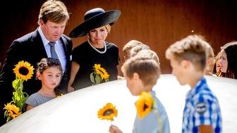 King Willem-Alexander and his wife Queen Maxima of the Netherlands attend an event to unveil a national monument to commemorate the victims of the Malaysia Airlines crash in Ukraine in 2014 in Vijfhuizen, Netherlands, July 17, 2017. REUTERS/Remko de Waal/Pool