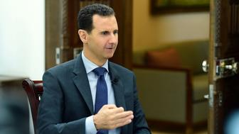 Syria's President Bashar al-Assad speaks during an interview with RIA Novosti and Sputnik in this handout picture provided by SANA on April 21, 2017, Syria. SANA/Handout via REUTERS ATTENTION EDITORS - THIS PICTURE WAS PROVIDED BY A THIRD PARTY. REUTERS IS UNABLE TO INDEPENDENTLY VERIFY THE AUTHENTICITY, CONTENT, LOCATION OR DATE OF THIS IMAGE. FOR EDITORIAL USE ONLY.