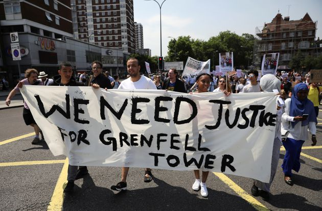 Demonstrators march during a protest about the Grenfell Tower fire, in