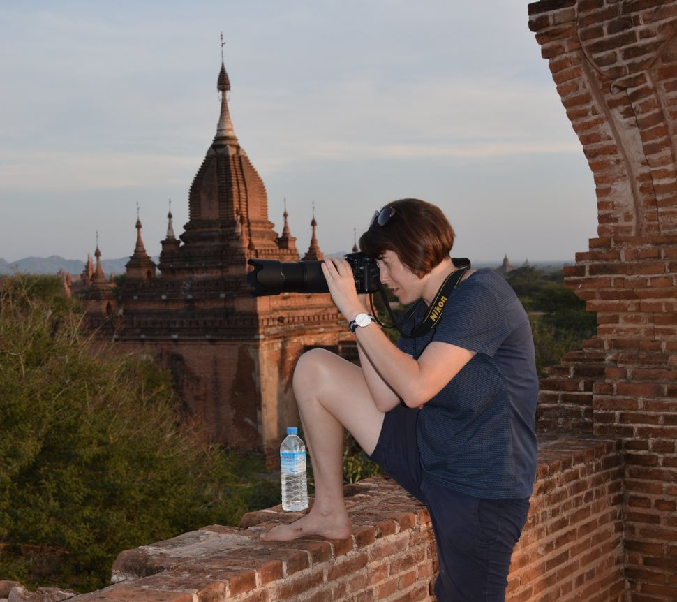 Harrison taking pictures in Bagan as inspiration for her etchings.