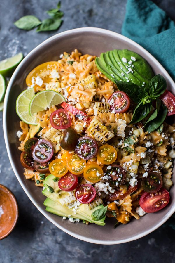 "<strong>Get the <a href=""https://www.halfbakedharvest.com/charred-corn-zucchini-enchilada-pasta-salad/"" target=""_blank"">Charr"