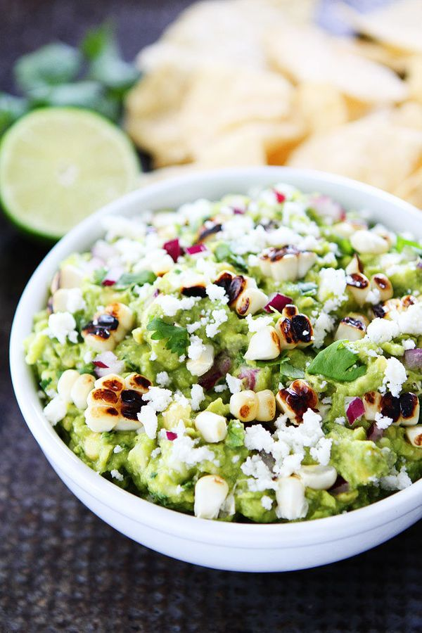 "<strong>Get the <a href=""https://www.twopeasandtheirpod.com/grilled-corn-guacamole/"" target=""_blank"">Grilled Corn Guacamole r"