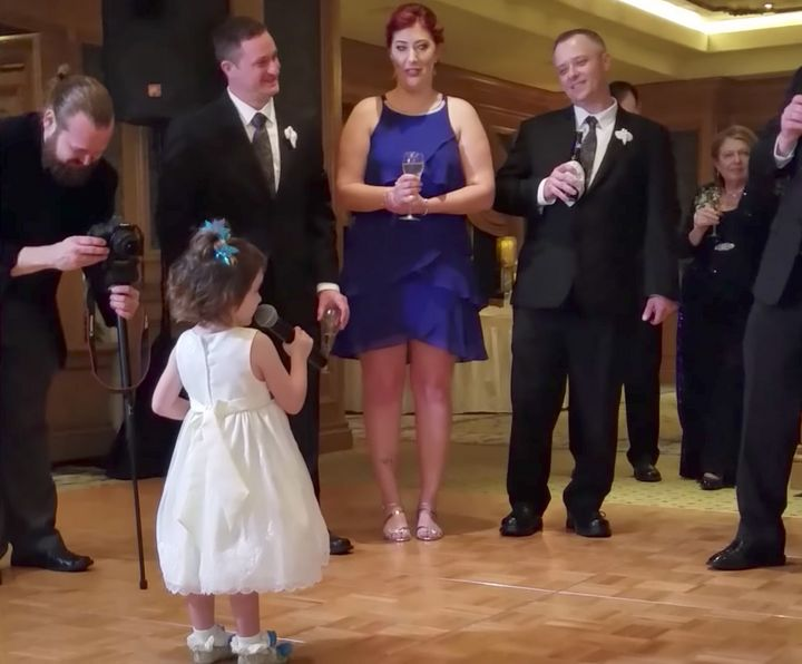A chatty little girl momentarily stole the show at a wedding when she offered a rambling, yet endearing, speech before the bride and groom.