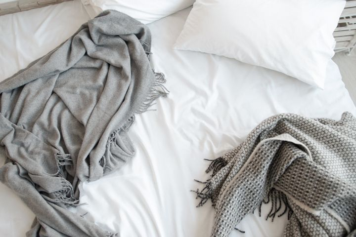 When choosing bedding to keep you cool, avoid synthetic materials and instead choose breathable natural fibers like cotton, e