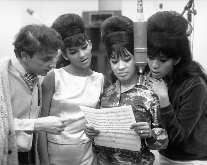 Phil Spector looked at sheet music with hit trio The Ronettes at Gold Star Studios in 1963.