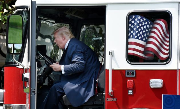 President Donald Trump examines a firetruck from Wisconsin-based manufacturer Pierce on the South Lawn...