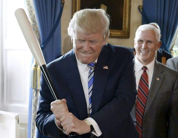 Trump gripsa Marucci baseball bat.
