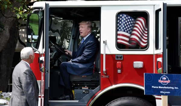 President Donald Trump seems to like the view from a firetruck made by Wisconsin-based Pierce Manufacturing as