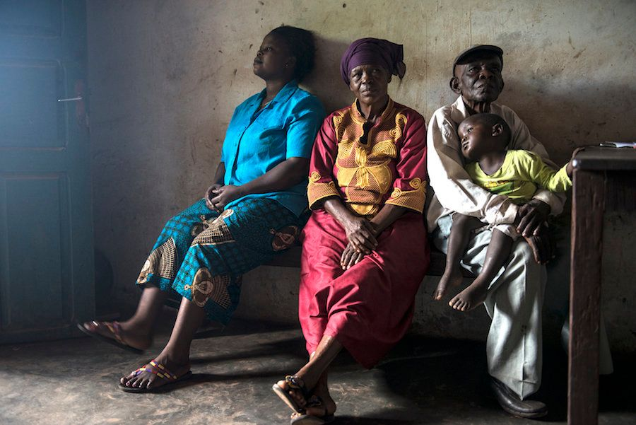 People waiting at a rural clinic in Congo, where river blindness is